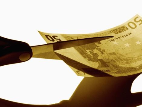 Scissors cutting money